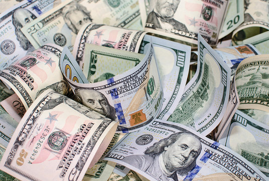 Background of twisted pile of dollar bills