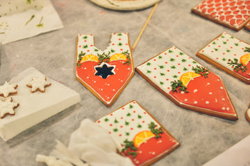 Gingerbread house making by hands. Christmas holiday.