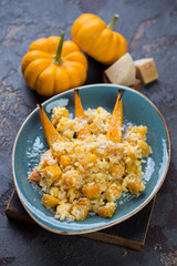 Pumpkin risotto with parmesan cheese, selective focus, vertical shot