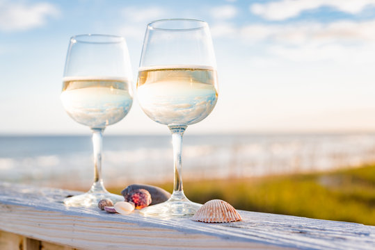 Wine at the beach with sea shells