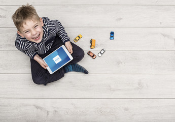 Child with Tablet on Wooden Patio Mockup 1