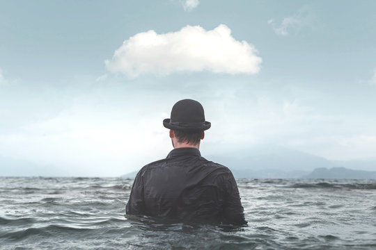 business man with bowler in the water