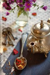 Dry tea leaves on spoon