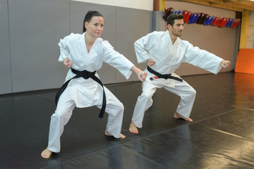 Man and woman in martial arts pose