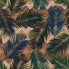 Seamless geo floral pattern with stylized palm leaves. Jungle foliage on geometric background. Vintage colors Textile design.