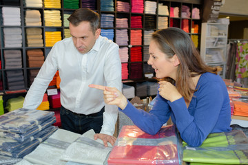 Couple in linen store