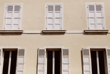 Building with wind shutters.