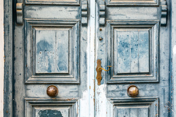 Symmetrical Detail of a Weathered Traditional Blue Door