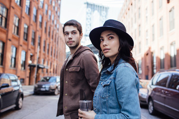 Young couple walking in Dumbo Area, Brooklyn, New York.