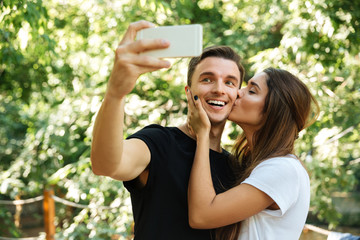 Portrait of a smiling happy man taking a selfie