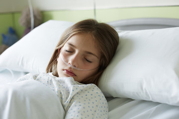 Close up of patient child sleeping in a hospital bed