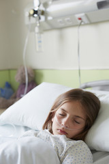 Patient child in a hospital bed sleeping
