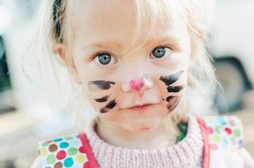 Little girl with a face paint