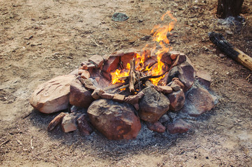 Medium sized campfire with rocks around it