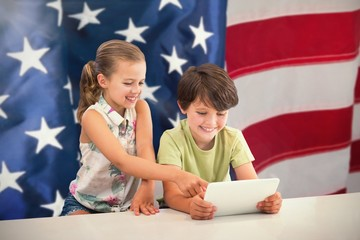 Composite image of boy with sister using digital tablet