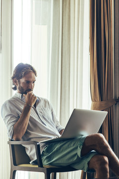 Man Working on a Laptop Computer at Home