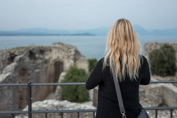 Blonde girl in Sirmione at Grotte di Catullo