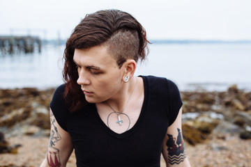 Portrait of gender fluid, transgender person on beach