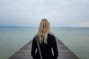 blonde girl at lake Garda