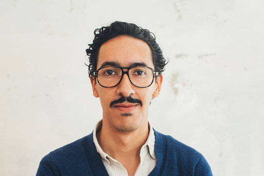 Headshot of Young Handsome Mexican Man With Glasses
