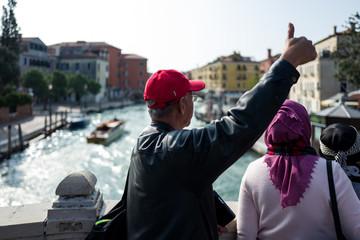 Tourist in Venice posing for camera