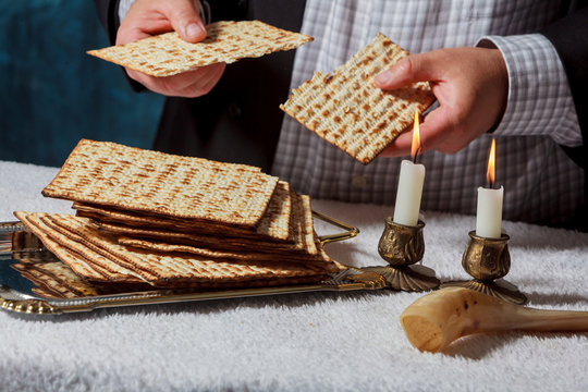 Jewish men is blessings matza for the Jewish holiday of Passover Seder meal