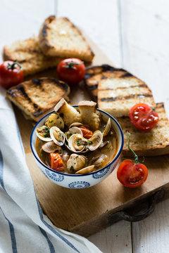 a bowl of littleneck clams soup