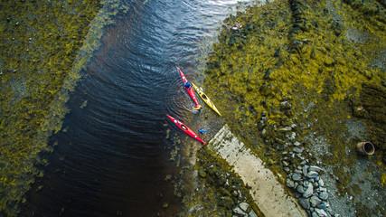 Aerial shot of kayakers preparing to paddle the ocean