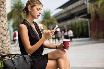 Businesswoman Checking Her Phone