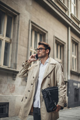 Young Businessman Making a Phone Call Outdoors