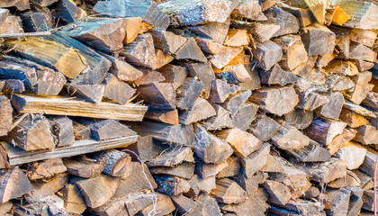 background texture full frame close up of a pile of firewood outdoors