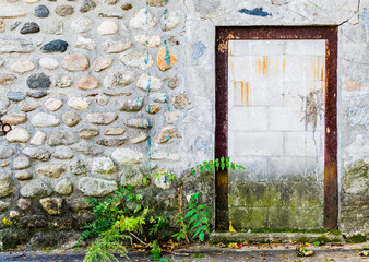 rusted doorframe in cobblestone wall of an abandoned New England building with copy space
