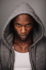 Serious young man in hooded sweatshirt