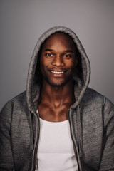 Studio shot of happy young man in hoodie