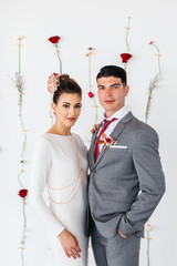 Portrait of two young adults in formal wedding attire
