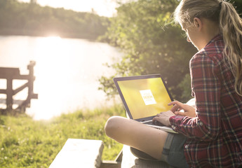 User with Laptop in the Outdoors Mockup 1