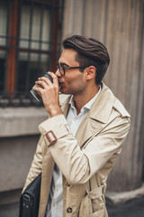 Portrait of a man drinking coffee.