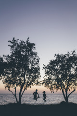 Silhouette of children on sunset