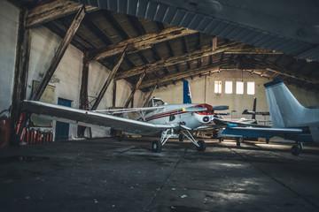 Old hangar with propeller planes.