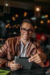 Stylish man working in a restaurant.