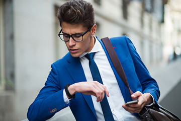 attractive businessman checking the time
