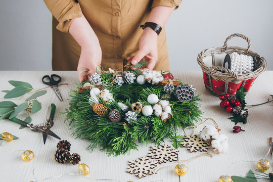Florist decorator making Christmas wreath