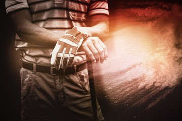 Composite image of man holding a golf club