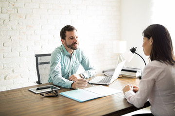 Man explaining agreement to client