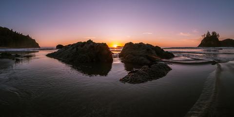 Coastal Sunset between rocks