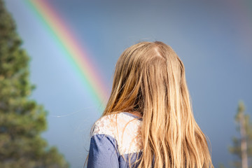 Young Girl Looking at a Rainbow