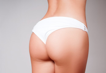 Beautiful slim woman body. Closeup of a beautiful woman showing perfect buttocks