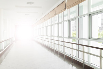 empty long corridor in the modern office building. background