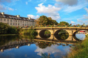 reflection of bridge on Nantes Brest canal in Pontivy Brittany France Wall mural
