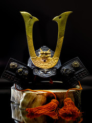 Kabuki Mask, Bushido Warrior Legend. Resin Made Skull with Bushido Iron Helmet and Kabuki Mask closeup on background.